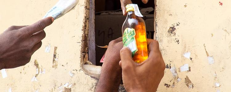 Unidentified men buy alcohol on November 5, 2014 in Delhi, India. Home delivery of alcoholic beverages is illegal in Delhi. Don Mammoser / Shutterstock.com
